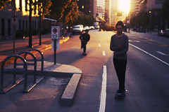 Skating Waterfront (m.tones) Tags: road street sunset canada vancouver d50 50mm golden nikon downtown waterfront skateboarding surrealism 14 surreal columbia hour british