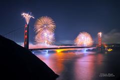 75th Anniversary Fireworks - Golden Gate Bridge (Darvin Atkeson) Tags: sanfrancisco california birthday bridge party skyline glow suspension fireworks towers 4th july celebration goldengatebridge baybridge bayarea inferno fortpoint marinheadlands towering citybythebay darvin 75thanniversary atkeson darv liquidmoonlightcom lynneal