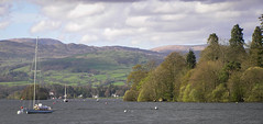 Beside the lake, beneath the trees (andyscho2004) Tags: uk blue trees england green 2004 water clouds spring unitedkingdom yacht britain lakedistrict olympus hills cumbria lakewindermere bowness bownessonwindermere c750uz