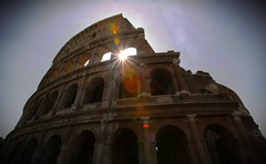 A flare for the Colosseum (D. Scott Taylor) Tags: flare sun architecture travel landscape sunburst colosseum rome italy