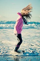 Might as well jump (The Green Album) Tags: sea beach wet water girl hair fun jump cornwall waves head tide rush splash