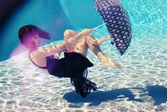 Bubblegum Girl (leslie.june) Tags: pink cute sunshine swimming umbrella happy bright floating bubbles hues bubblegum underwaterphotography girlunderwater lightcaustics underwaterphotographybylesliejune