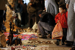 Child looking at wares at midnight in Marrakesh, Morocco (Simon Christiaanse) Tags: africa street city people night lowlight child market streetphotography morocco midnight medina merchandise marrakesh fleemarket wares  simonchristiaanse