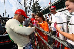 Tony Kanaan signs autographs (indianapolismotorspeedway.com) Tags: camera cars speed canon eos indianapolis 101 length mode rating drivers ims racecars indy500 indycar indianapolis500 indianapolismotorspeedway racecardrivers bumpday indycardrivers 50dexposure 5focal 400metering 1250fnumber 181iso