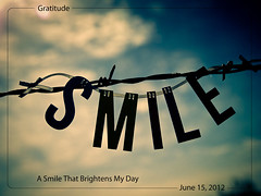 June 15, 2012 Smile (susiecw47) Tags: blue sky smile sunshine clouds outdoors wire olympus potd barbedwire 365 barbs e500