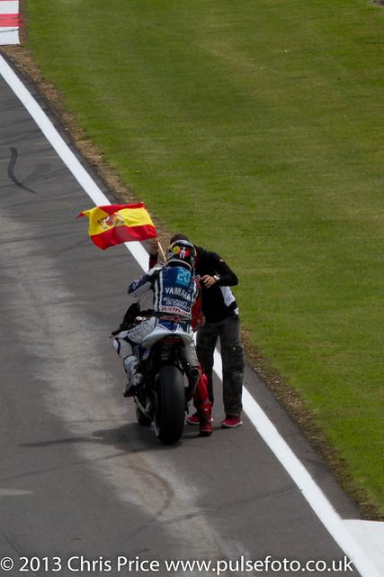 Jorge Lorenzo grabs a flag