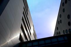 Opposites (Wim van Bezouw) Tags: blue sky building architecture modern concrete steel