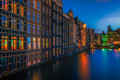 Amsterdam By Night (angheloflores) Tags: longexposure travel houses sky urban holland colors amsterdam architecture night clouds reflections lights canal explore damrak nehterlands