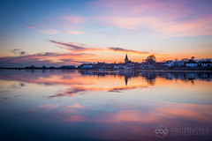 Bosham, West Sussex (chrisbutton68) Tags: sunset england reflection church horizontal creek sussex landscapes bosham westsussex harbour outdoor scenic peaceful estuary spire picturesque tranquil channel saxon hightide chichester kingharold kingcanute
