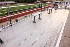 aluminum seating at a high school stadium (DigiDreamGrafix.com) Tags: show new wallpaper people game sports up architecture buildings tickets concrete concert aluminum waiting drink none stadium many no steel space empty steps structure highschool clean arena rows seats infrastructure huge neat fold anticipation seating copy lots holder tidy pristine foldup