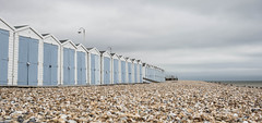 Deserted beach (V Photography and Art) Tags: blue sky beach clouds pov perspective pebbles pointofview beachhuts