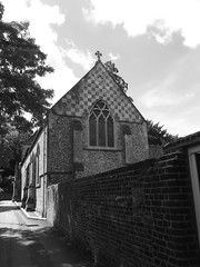 Church of St Michael (curly_em) Tags: door windows sky blackandwhite building church monochrome clouds outside outdoors shadows hampshire shade winchester flint