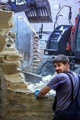 Joy of Destruction (thewhitewolf72) Tags: abriss baustelle bauarbeiter freude zerstrung mauer haus steine genuss lcheln staub