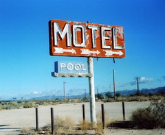 Motel (Nick Leonard) Tags: old blue arizona sky orange classic abandoned film pool sign analog vintage closed desert kodak nick 110 motel roadtrip scan retro signage arrows neonsign yucca timeless instamatic expiredfilm fujisuperia colorfilm 110camera 110film kodakcamera epson4490 expired2003 kodakinstamatic20 vacent nickleonard fujisuperia110 fujifilm110 believeinfilm