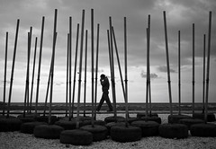 (ssj_george) Tags: sea walking lens lumix person cyprus tires panasonic poles pancake 20mm umbrellas tyres dmc larnaca f17 gf1 κύπροσ λάρνακα