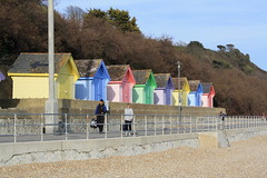 Pass the beach huts (Samantha Elle) Tags: street pink blue green beach yellow kent colours bright stones shingle multicoloured pebbles huts colourful beachhuts folkestone