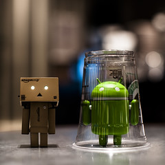 Bad Danbo! (Issa Fakhro) Tags: danbo android toys funny hilarious humor bad evil revoltechdanboard cafeteria caf malm sweden afternoon friday may 2012 bokeh lights espressohouse urban city canon 50mm photography photos flickr issafakhro followmeontwitterissafakhro