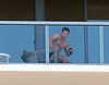 Mark Wahlberg relaxes on his balcony with a friend wearing tight black underwear at Miami Beach Miami Beach, Florida