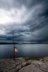 The Sentinel (szefi) Tags: lake storm nature rain weather night clouds canon landscape coast long exposure cloudy sweden stockholm sigma le shore nd sverige lifebuoy 1020 buoy lifepreserver mlaren hsselby hsselbystrand varind sigma1020f456exdchsm singhray impendingrain 60d canoneos60d singhrayvarind