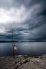 The Sentinel (szefi) Tags: lake storm nature rain weather night clouds canon landscape coast long exposure cloudy sweden stockholm sigma le shore nd sverige lifebuoy 1020 buoy lifepreserver mälaren hässelby hässelbystrand varind sigma1020f456exdchsm singhray impendingrain 60d canoneos60d singhrayvarind