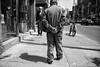 Clasped (alisdair jones) Tags: street leica toronto man west 35mm walking queen pedestrians summilux m9
