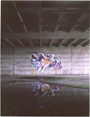 Flip ([jonrev]) Tags: camera color reflection tower abandoned film water vintage polaroid graffiti hotel high ruins paint antique garage parking indiana tags coh spray will add flip land instant someone gary these peel rise sheraton because anyway decaying 250 ue fui apart urbex packfilm fp100c