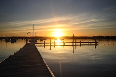 Bright (pominoz) Tags: sunset lake reflections pier boat yacht jetty valentine wharf nsw flare lakemacquarie