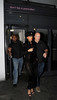 Rihanna arriving at Boujis nightclub in Kensington, wearing a black beanie hat and a black lace bodysuit, showing her black underwear underneath. London, England