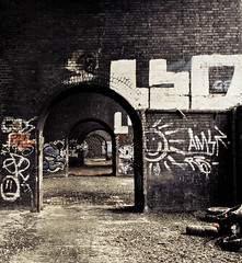 Under the bridge (Stacy Johnson 1) Tags: old city bridge england brick abandoned broken stone manchester graffiti industrial arch dirty litter archway derelict citycentre