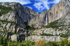 Yosemite Falls in the Fall (Dave Toussaint (www.photographersnature.com)) Tags: california ca travel vacation sky panorama usa cloud mountain tree yosemitefalls nature water northerncalifornia forest photoshop canon river landscape photo nationalpark interestingness high interesting october bravo skies photographer dynamic stitch cs2 wide picture screen panoramic explore upper adobe valley yosemite granite lower range hdr yosemitevalley adjust watefall polarizing 2011 polarize autopanopro denoise 60d topazlabs photographersnaturecom davetoussaint photoengine oloneo flickrstruereflection1