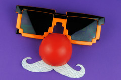 I mustache you to seriously be silly          60/100 (Marked_man) Tags: red orange black sunglasses paper fun nose funny purple humor laugh laughter mustache comicrelief 16bit 100possibilitiesproject