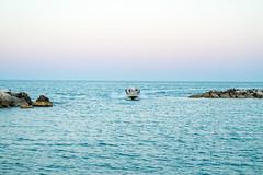 Speedy Boat (Leonardo Caggianelli) Tags: blue sunset sea sky italy water colors landscape boats boat seaside italia waves samsung cliffs marche samsungnx samsungnx3000