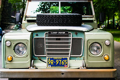 Land Rover (pillarsoflight) Tags: blue trees brown white reflection green classic beauty oregon portland prime grey aperture nikon rust tire front grill bumper adobe pdx headlight suv pnw lightroom turnsignal 18 35 d3300