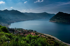 Lago d'Iseo (s.W.s.) Tags: italien trees light sky italy sun lake mountains nature water clouds landscape island see italia view outdoor north hills insel lombardia lombardy iseo lagodiseo marone sebino