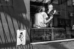 Why me? (amira_a) Tags: bw baby window kid fuji fujifilm vetrina gaze whyme x100 kidlooking x100s kidgazing