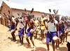 Traditional Dancers welcome UNDP Associate Administrator Rebeca Grynspan to Tetugu village in Gulu