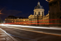 Long exposure in front of the Institute of France (julien. H) Tags: blue light red paris france color building cars yellow night speed canon de blurry long exposure time lumire ghost trace trails fast images institute rides nuit phare cary institut patrol feu chasing hallucinations phares 400d