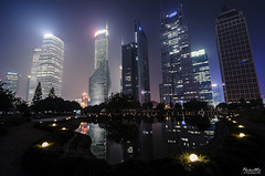 Greenpark Lujiazui Cityscape (Shanghai) (Andy Brandl (PhotonMix)) Tags: china city longexposure urban lake misty skyline modern night reflections lights nikon asia cityscape skyscrapers shanghai illumination led eggs glowing hightech pudong futuristic polished lujiazui lujiazuifinancialdistrict lujiazuicentralgreen d7000 photonmix andybrandl