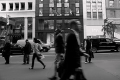 Di (trhee_) Tags: nyc people bw ny blur canon walking t2i thattrheeblogspotcom