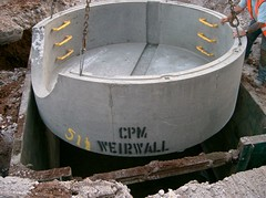 CPM weir wall installation (CPM Group) Tags: pipe ring cp penstock concretepipe weirwall hydrobrake drainageproducts cpmgroup chamberring nonreturnflapvalve precastconcretechamberring flowcontrolchambers