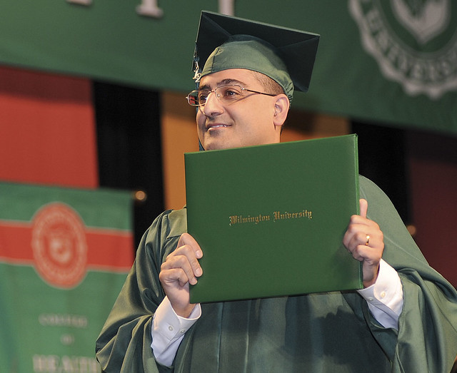 A proud graduate at the Spring Commencement Ceremony.