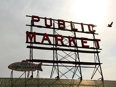 Pike Place Market Sign with Pigeon (Mr.TinDC) Tags: fish signs sign flying washington inflight pigeon pigeons signage wa pikeplacemarket pikeplace neonsigns publicmarket cityfishmarket neonfish
