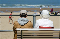 Blinded (m.pressions) Tags: old sea summer people beach water hat horizontal strand sand belgium belgique belgie caps young hats cap oostende cushion