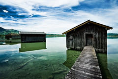 boat houses. kochelsee, bavaria (michael baumann) Tags: sky lake alps reflection clouds bavaria countryside spring dock oberbayern upperbavaria boathouse 2012 clearwater steg kochelsee michaelbaumann lakekochel