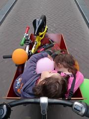 damstraat-bakfiets-kids-sleeping-balloons-bikes (henry in a'dam) Tags: family sleeping holland netherlands amsterdam bicycle kids balloons kinderen bikes henry p1 p2 fiets cargobike bakfiets kinderfiets loopfiets workcycles