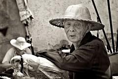 Still Working (Valerie Rosen) Tags: travel people men sepia portraits thailand nikon hats streetphotography photojournalism documentary elderly chiangmai blackandwhitephotography environmentalportraits valerierosen