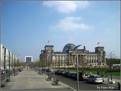 BERLIN (voar alto one) Tags: street trees sky people building cars clouds lawn flags dome lamps benches bycicles