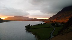 Sunset across the lake (gowersaint) Tags: road eve trees light sunset england lake water weather clouds dark golden evening countryside glow shadows view britain country shoreline lakedistrict peaceful hills shore silence cumbria rays peaks hillside setting picturesque stillness fell crummockwater rannerdale