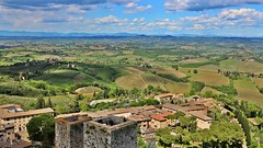 Typical Tuscany's countryside (Emanuele Barcali) Tags: vacation sky italy sun black green tower love clouds countryside photo san artist view gimignano weekend withe sunny medieval hills tuscany sangimignano castello borgo castel torri blackwithe togheter