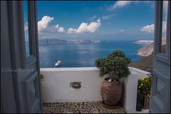 From my door.  Thira (Claire Pismont) Tags: door travel blue cloud color colour volcano colorful balcony bleu caldera nuage couleur thira fira volcan travelphotography documentory pismont clairepismont